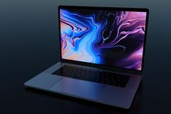 MacBook Pro 15`` similar laptop computer in dark scene. Laptop computer, design similar to MacBook Pro 15 inch, 2018, Space Grey. Dark scene, glowing screen royalty free stock images
