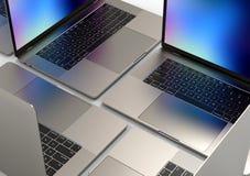 MacBook Pro style laptop computers, composition stock photo