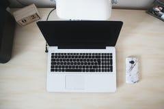 Macbook Beside Smartphone on Desk Stock Photos