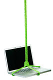 Macbookpro hangs. Laptop hangs on a green cord. Image isolated in my studio. Image isolated in my studio Royalty Free Stock Photography