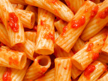 Maccheroni pasta in tomato sauce food background Royalty Free Stock Photo