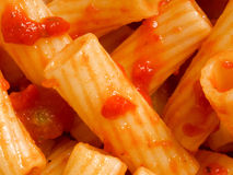 Maccheroni pasta in tomato sauce food background Royalty Free Stock Images