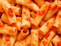 Maccheroni pasta in tomato sauce food background Stock Photos