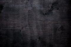Macchia colorata fondo di legno nero dell'estratto del compensato fotografia stock