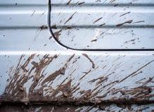 Macchia di fango dal lato dell'automobile fotografia stock