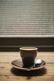 Macchiato coffee on old wood table Royalty Free Stock Photos