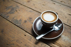 Macchiato coffee on old wood table Stock Images