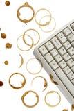 Macchie del caffè e del calcolatore Immagini Stock