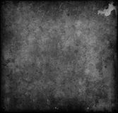 Macchie di Balck che coprono e di piastra metallica arrugginito Fotografie Stock