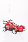 macchina da corsa rossa del giocattolo su fondo bianco fotografia stock libera da diritti