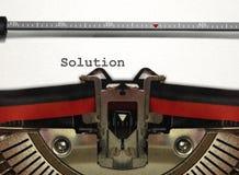 Macchina da scrivere con la parola della soluzione Immagini Stock Libere da Diritti