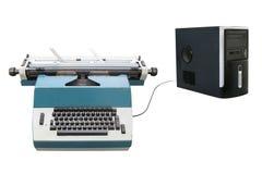 Macchina da scrivere e un computer portatile fotografia stock