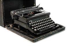 Macchina da scrivere nera su fondo bianco fotografie stock