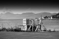 Macchina del caricatore del carico nel fondo del porto di Tromso Fotografia Stock Libera da Diritti