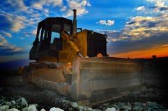 Macchina del motore della terra ad alba Fotografia Stock