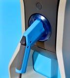 Macchina della pompa di gas e pistola di combustibile blu Fotografia Stock Libera da Diritti