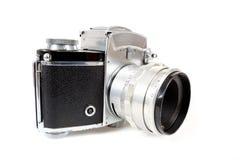 Macchina fotografica analogica della foto della retro vecchia annata su bianco Immagine Stock