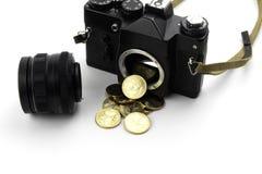 Macchina fotografica con i dollari che versano da  immagine stock libera da diritti