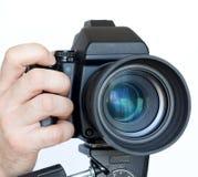 Macchina fotografica con l'obiettivo Immagine Stock