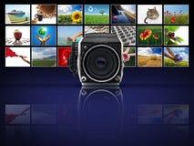 Macchina fotografica con le fotografie Immagine Stock