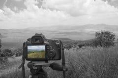 Macchina fotografica con paesaggio Immagini Stock Libere da Diritti