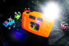 Macchina fotografica del giocattolo e modello dell'automobile immagini stock libere da diritti