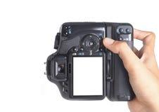 Macchina fotografica della holding della mano fotografia stock