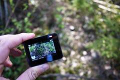 Macchina fotografica di azione per catturare i vostri video Adatto a viaggio di automobile, sport, immersione subacquea, fotografie stock libere da diritti