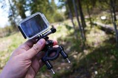 Macchina fotografica di azione per catturare i vostri video Adatto a viaggio di automobile, sport, immersione subacquea, immagine stock libera da diritti