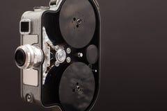 Macchina fotografica di cinematografia sulla camma d'annata nero- Immagini Stock