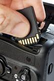 Macchina fotografica di deviazione standard e di DSLR del flash card Fotografia Stock