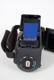 Macchina fotografica di Digitahi con la scheda di memoria di deviazione standard Fotografie Stock