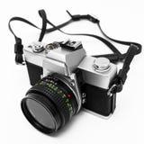 Macchina fotografica di Digitahi isolata su priorità bassa bianca DSLR Immagine Stock
