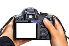 Macchina fotografica di DSLR isolata su bianco Immagine Stock