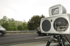 Macchina fotografica di velocità Immagini Stock