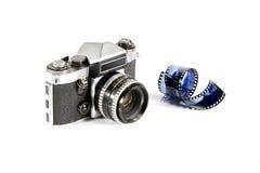 Macchina fotografica e pellicola riflesse della foto Fotografia Stock