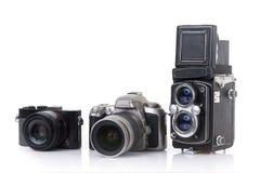 Macchina fotografica moderna del dslr, macchina fotografica compatta e formato medio d'annata due Fotografie Stock