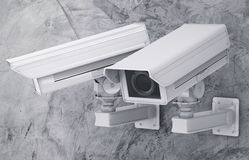 Macchina fotografica o videocamera di sicurezza del Cctv sul fondo del cemento Fotografie Stock Libere da Diritti