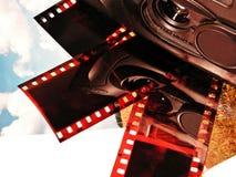 Macchina fotografica, pellicole e foto Immagine Stock