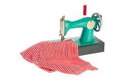 Macchina per cucire con i vestiti immagini stock libere da diritti