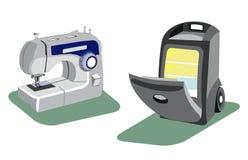 Macchina per cucire e un frigorifero per l'automobile Fotografia Stock