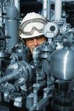Macchinario dell'olio e dell'assistente tecnico Immagini Stock Libere da Diritti