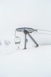 Macchinario e neve della cabina di funivia Fotografia Stock Libera da Diritti