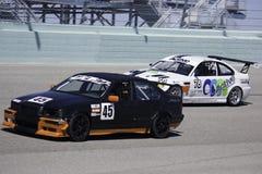 Macchine da corsa alla gara motociclistica su pista di Miami della fattoria Immagini Stock
