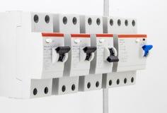 macchine elettriche, commutatori, su fondo bianco, primo piano Fotografie Stock