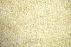 Macchioline di scintillio dell'oro su fondo bianco Fotografia Stock