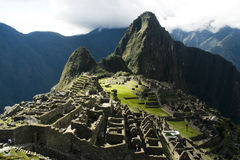Macchu Picchu. The ancient Inca city of Macchu Picchu, Peru, close up of ruins with winha Picchu in background and clouds in sky Royalty Free Stock Photos