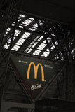 Macdonald sign at train station in Frankfurt, Germany Royalty Free Stock Photos
