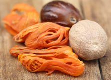 Mace or Javitri Spice with nutmeg. On wooden surface Royalty Free Stock Image