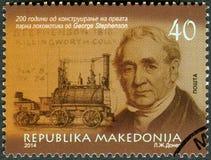 MACEDONIA - 2014: shows portrait of George Stephenson 1781-1848, civil engineer and mechanical engineer. MACEDONIA - CIRCA 2014: A stamp printed in Macedonia Royalty Free Stock Photos